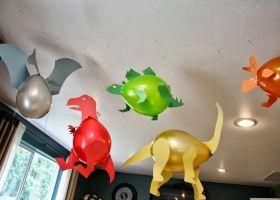 Ingeniosos dinosaurios con globos